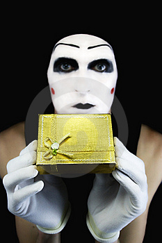 Sad mime wants to give you a present. How sweet.